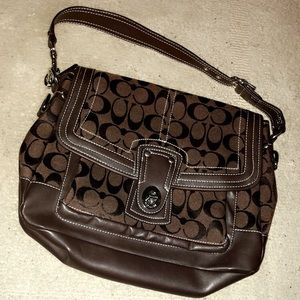Chocolate brown turnlock COACH purse
